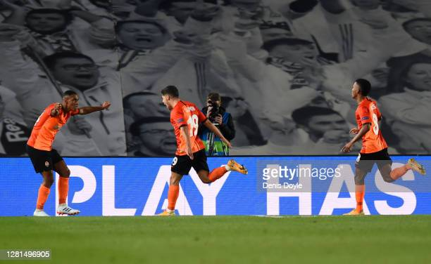 Manor Solomon of Shakhtar Donetsk celebrates with teammates after scoring his sides third goal during the UEFA Champions League Group B stage match...