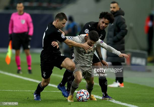 Manor Solomon of Shakhtar Donetsk is challenged by Stefan Lainer and Valentino Lazaro of Borussia Moenchengladbach during the UEFA Champions League...