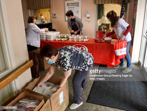 ManorCare Administrator Ginny Johnson helps to unpack the lunch items At ManorCare Health Services West Reading North Friday morning May 22 2020...