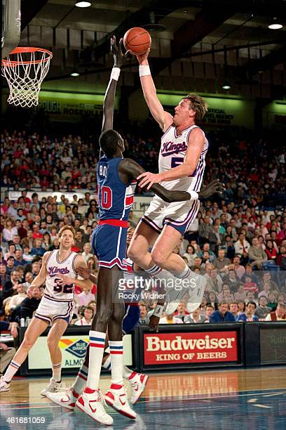 Manote Bol of the Washington Bullets blocks a shot attempt by Mark Olberding of the Sacramento Kings during a game played on February 14 1987 at Arco...