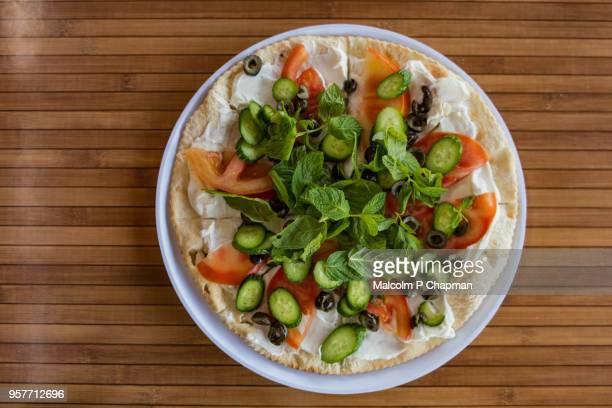manouche, lebanese flatbread, with labneh strained yoghurt, tomatoes and mint, beirut, lebanon - beirut stock pictures, royalty-free photos & images