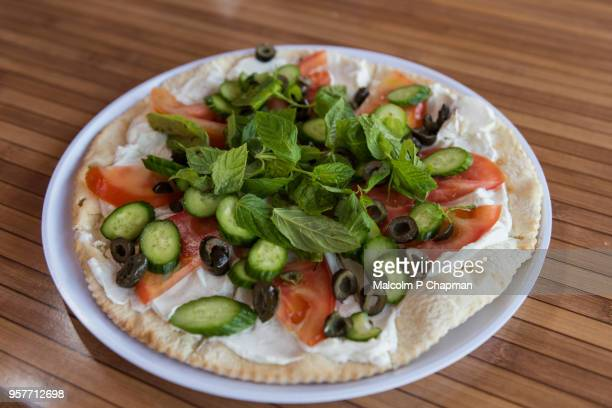 manouche, lebanese flatbread, with labneh strained yoghurt, tomatoes and mint, beirut, lebanon - lebanon stock photos and pictures