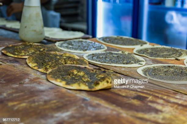 manouche, lebanese flatbread, with zaatar - beirut stock pictures, royalty-free photos & images