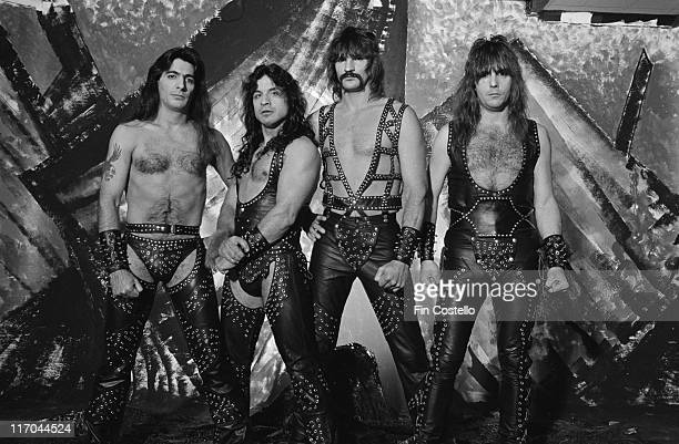 Manowar drummer Scott Columbus guitarist Ross Friedman bassist Joey DeMaio and singer Eric Adams US heavy metal band wearing their stage costumes of...