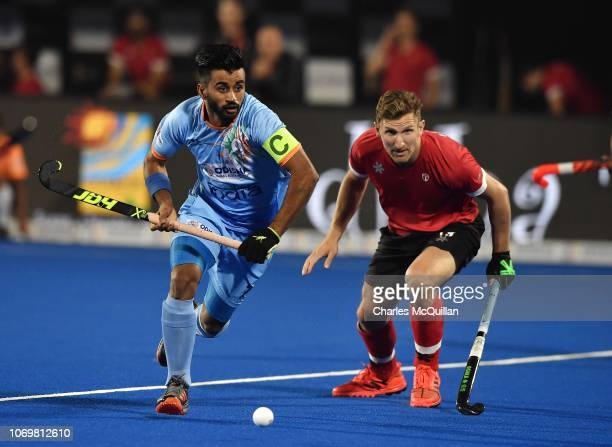 Manpreet Singh of India and Mark Pearson of Canada during the FIH Men's Hockey World Cup Pool C match between India and Canada at Kalinga Stadium on...