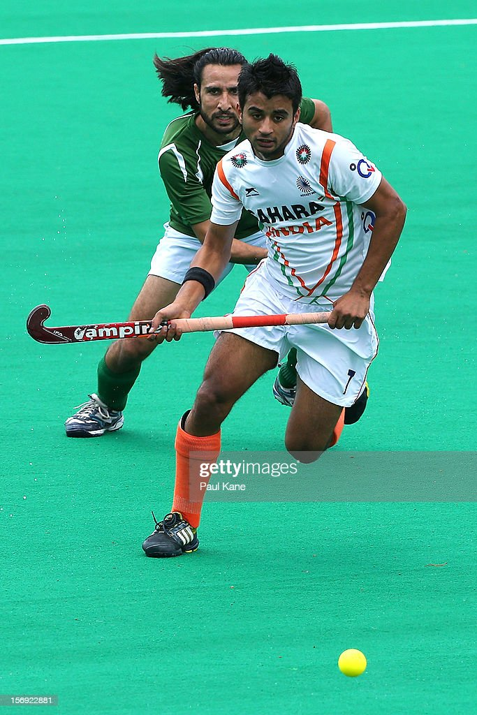 Manpreet Singh of India and Shakeel Abbasi of Pakistan contest for the ball in the mens bronze medal play off between India and Pakistan during day four of the 2012 International Super Series at Perth Hockey Stadium on November 25, 2012 in Perth, Australia.