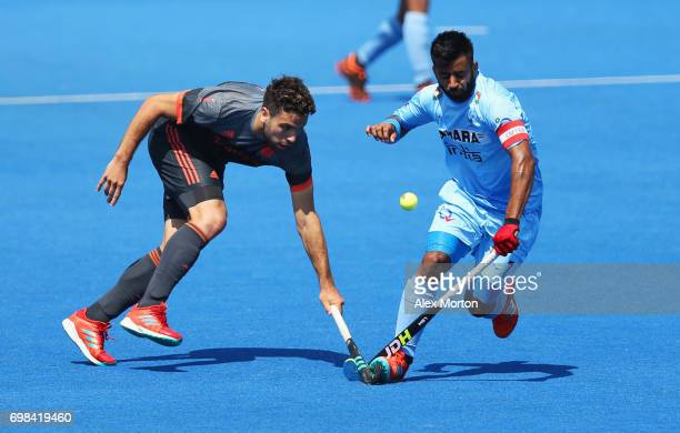 Manpreet Singh of India and Valentin Verga of the Netherlands battle for the ball during the Pool B match between India and the Netherlands on day...