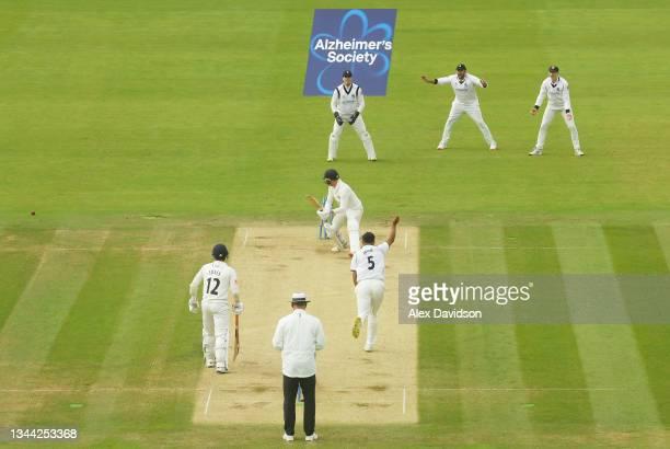 Manraj Johal of Warwickshire bowls Luke Wood of Lancashire with teammates during Day 4 of the Bob Willis Trophy Final between Warwickshire and...