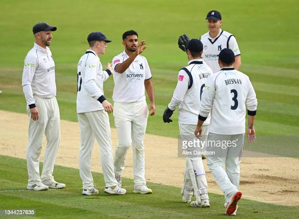 Manraj Johal of Warwickshire celebrates the wicket of Luke Wood of Lancashire with teammates during Day 4 of the Bob Willis Trophy Final between...