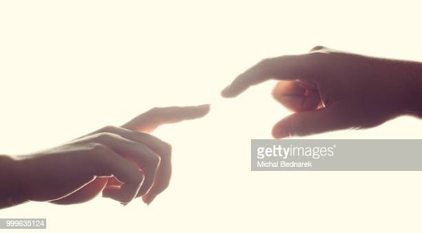 Man's and woman's hands, fingers reaching each other. Love, connect, help concepts.