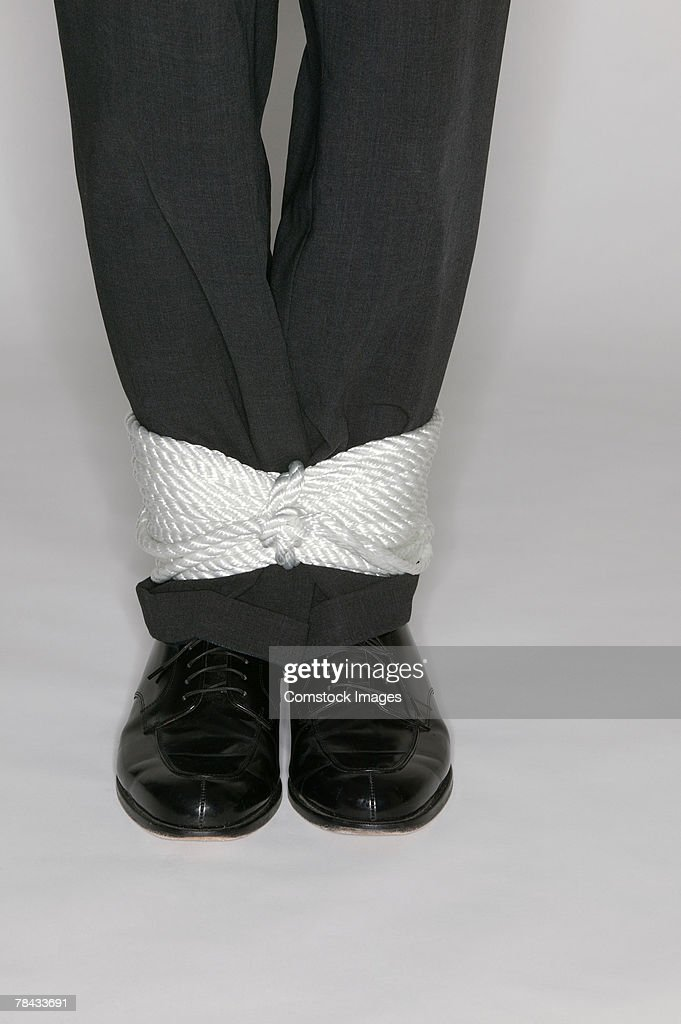 Man's ankles tied together : Stockfoto