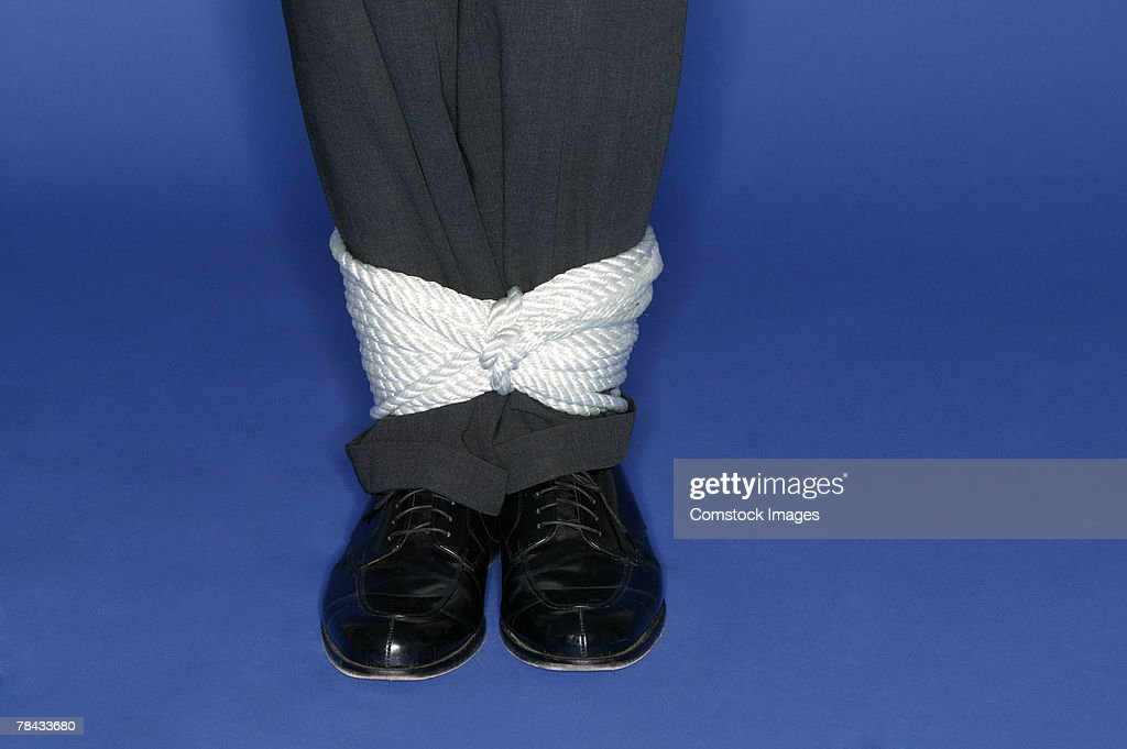 Man's ankles tied up : Stockfoto