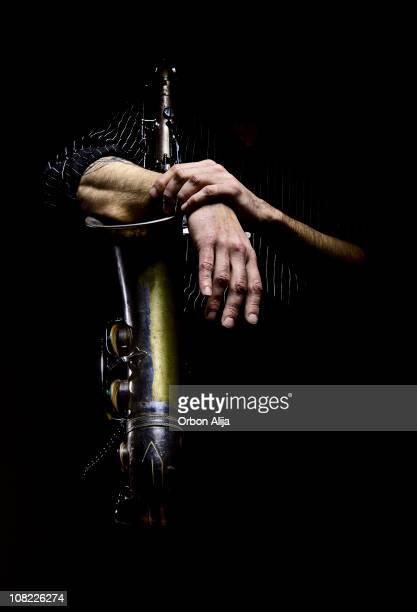 Man's Arms Wrapped Around Saxophone, Low Key
