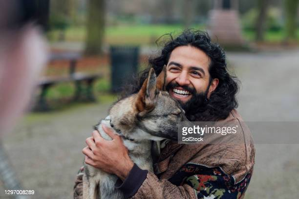 mans best friend - men laughing stock pictures, royalty-free photos & images