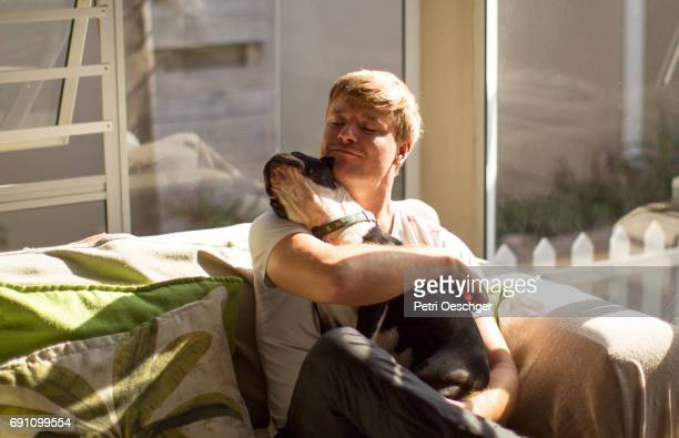 man's best friend. - hairy man stock pictures, royalty-free photos & images