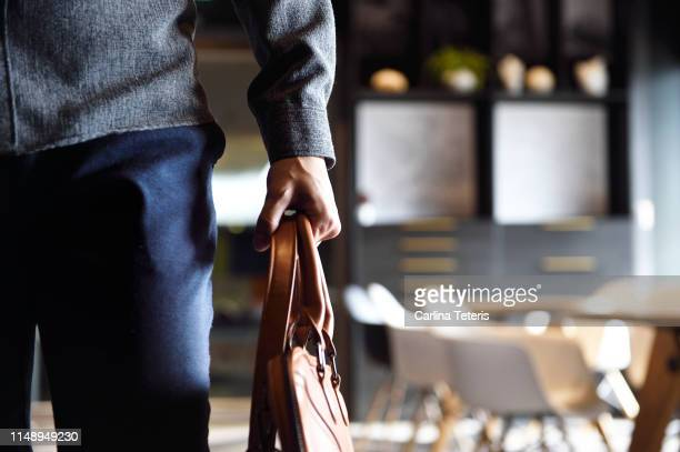 man's body walking through an office - arrival stock pictures, royalty-free photos & images