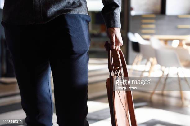 man's body walking through an office - loafers stock pictures, royalty-free photos & images