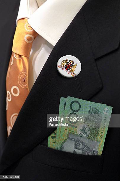A man's breast pocket filled with 100 dollar notes 22 July 2003 AFR Picture by JESSICA SHAPIRO