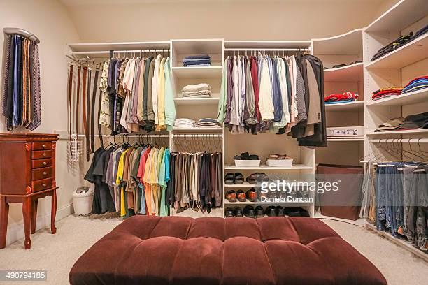 A man's closet fully organized