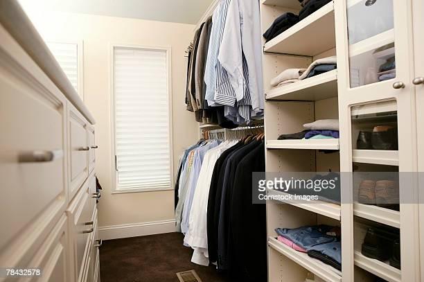 man's closet - walk in closet stock photos and pictures