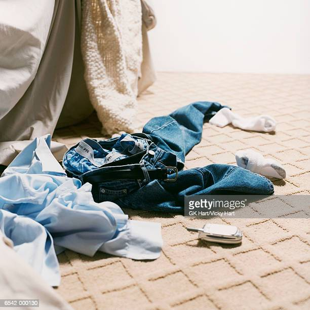 man's clothes on bedroom floor - knickers stock pictures, royalty-free photos & images