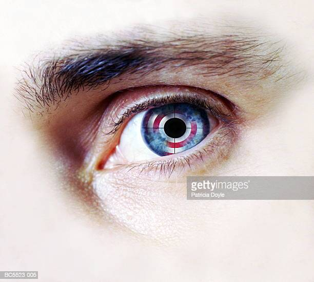Man's eye with cross-hairs and reflected target (Composite)