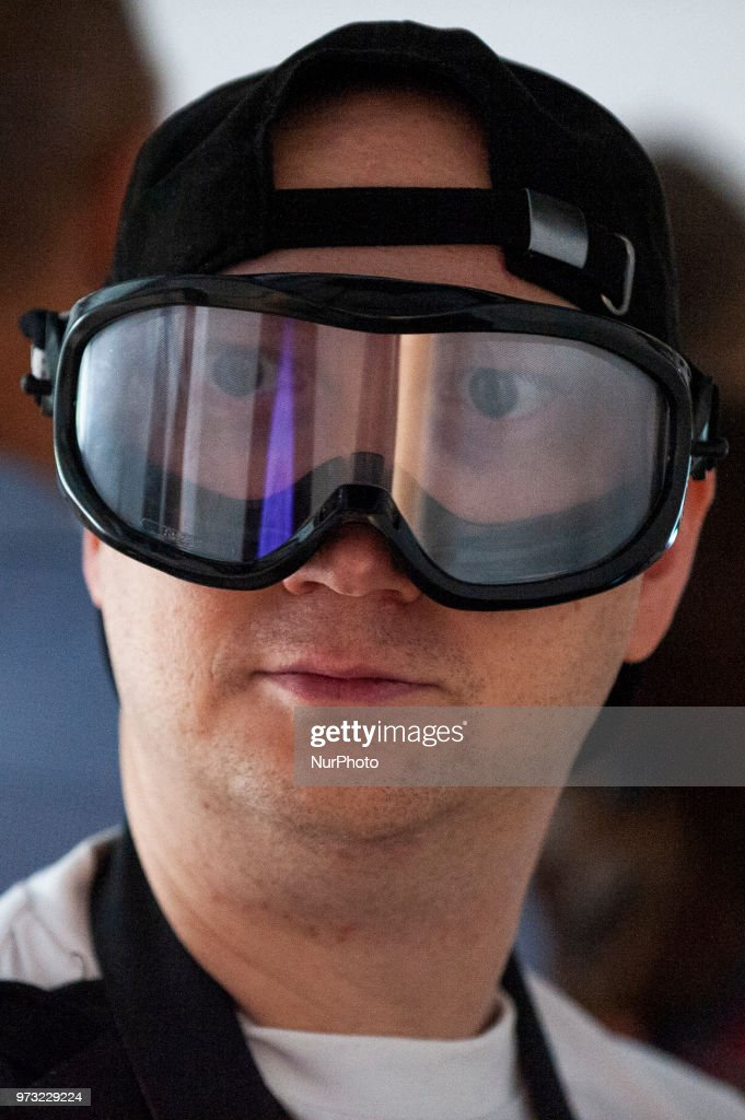A man's eyes appear enlarged through goggles that simulate drunkenness at the Polish Vodka Musuem on June 12, 2018 in Warsaw, Poland.