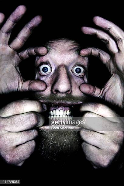 mans face being pulled - scott macbride stock pictures, royalty-free photos & images