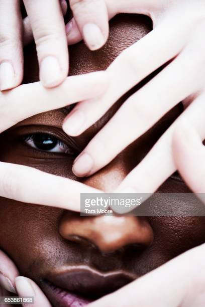 mans face covered with hands - unfairness stock pictures, royalty-free photos & images