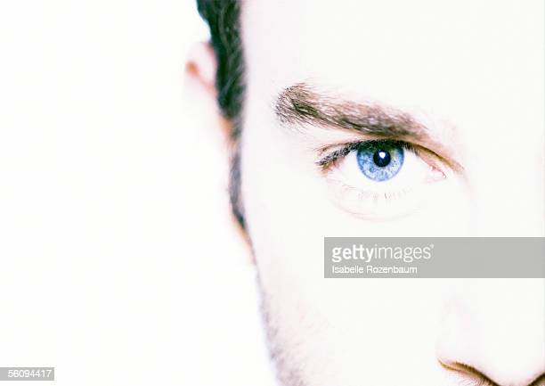 man's face, partial view, close-up, portrait - high key stock pictures, royalty-free photos & images