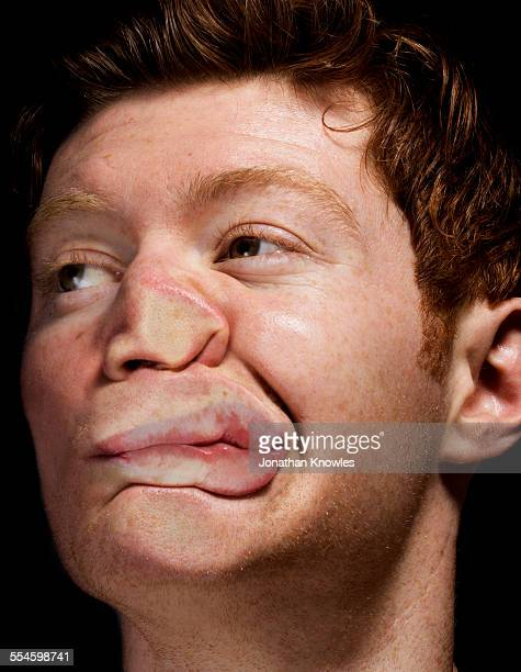 Man's face pressed against glass