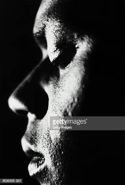 Man's face, profile, close-up (B&W)