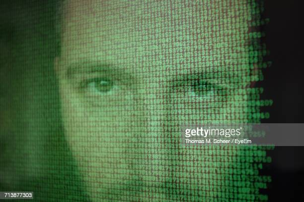 Mans Face Reflected In Computer Screen With Binary Code