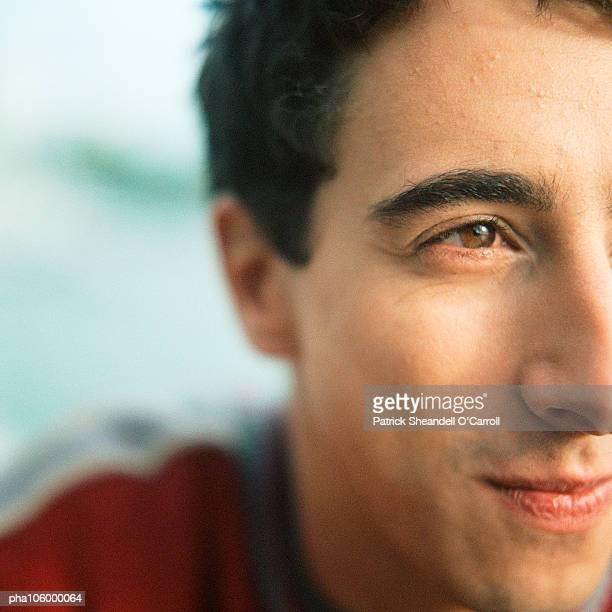 Man's face smiling, close-up