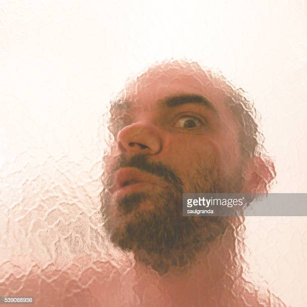 Man's face squished against glass