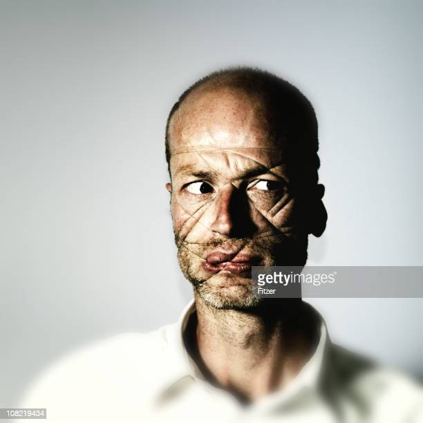 man's face wrapped in wire string - ugly bald man stock photos and pictures