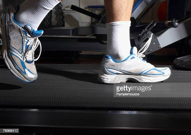 man's feet on a treadmill in a gym - old man feet stock pictures, royalty-free photos & images