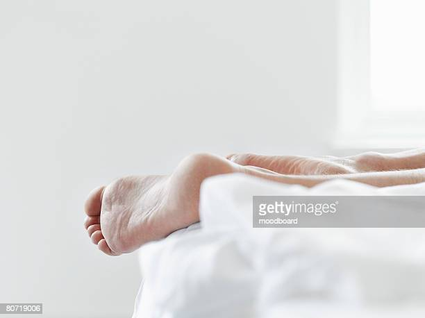 Man's Feet on Bed