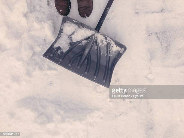 Mans Feet With Shovel In Snow