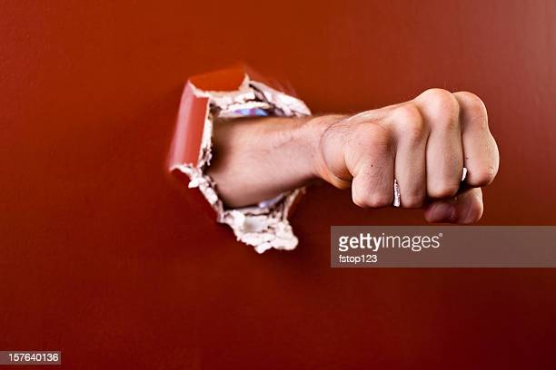man's fist coming through wall. - punching stock pictures, royalty-free photos & images