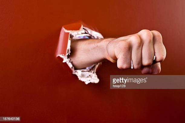 man's fist coming through wall. - slaan met vuist stockfoto's en -beelden