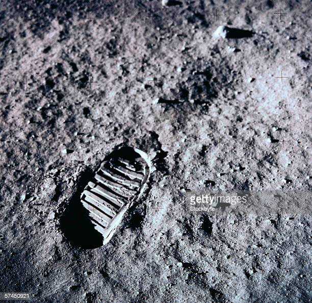 A man's footprints on the surface of the moon