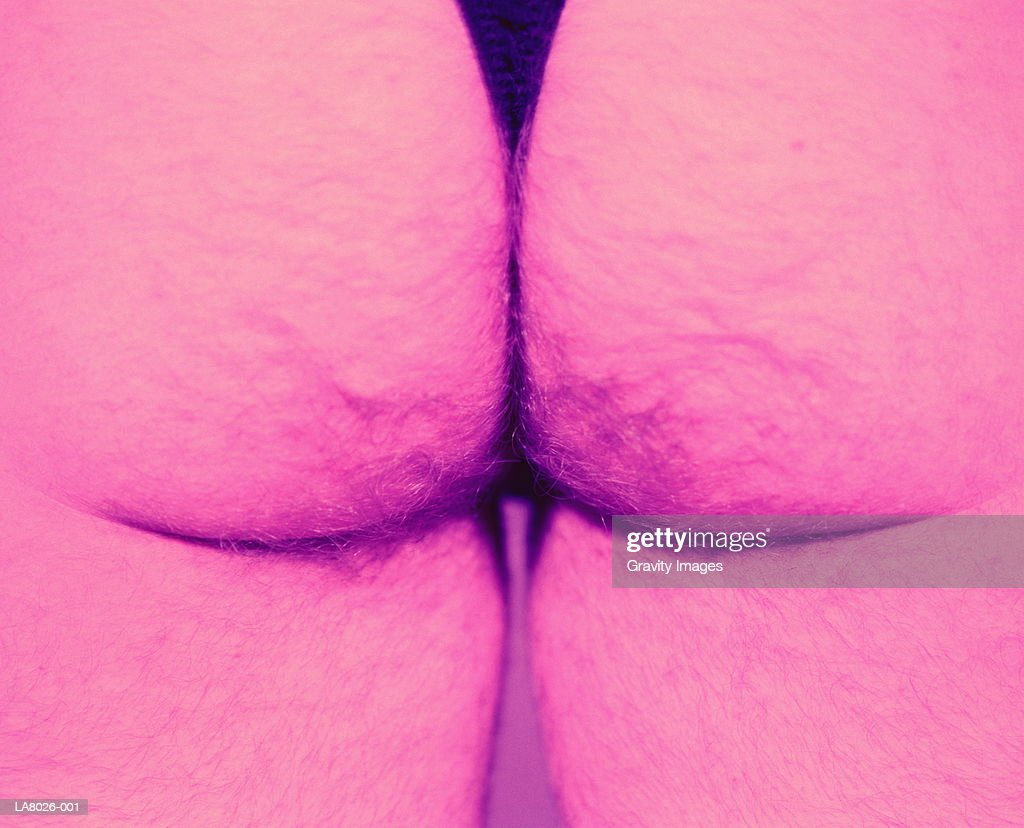Man's hairy buttocks, close-up (cross-processed) : Stock Photo