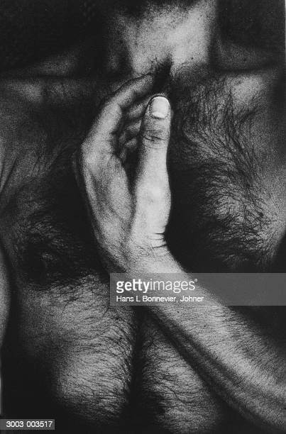 man's hand and chest - hairy chest stock-fotos und bilder