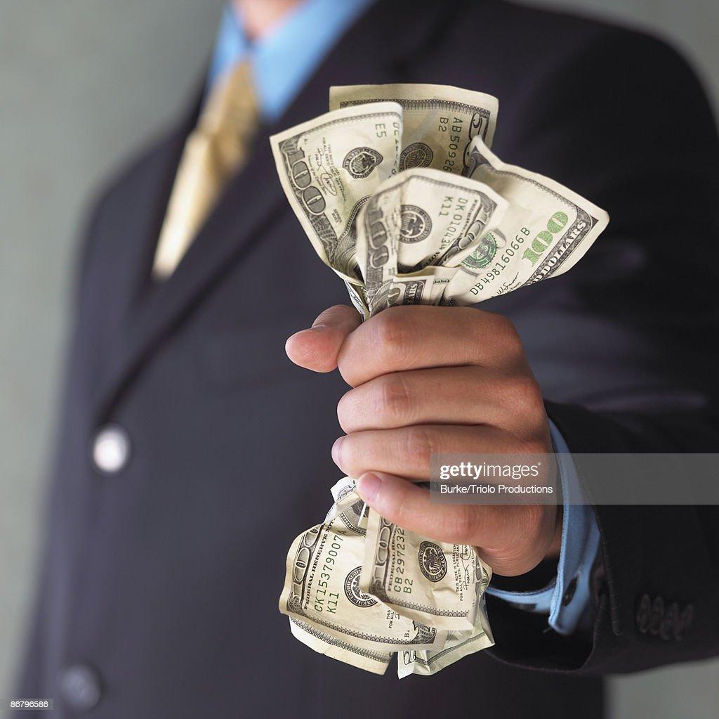 Man's hand holding cash : Stock Photo