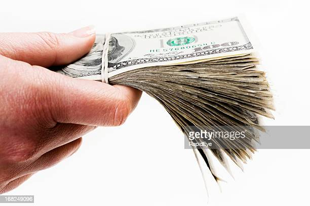 Man's hand holds out bundle of US dollars