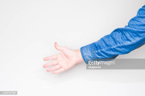 man's hand on light background - long sleeved stock pictures, royalty-free photos & images