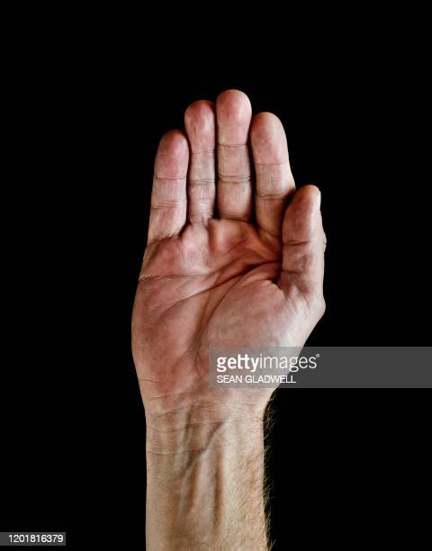man's hand raised up - bid stock pictures, royalty-free photos & images