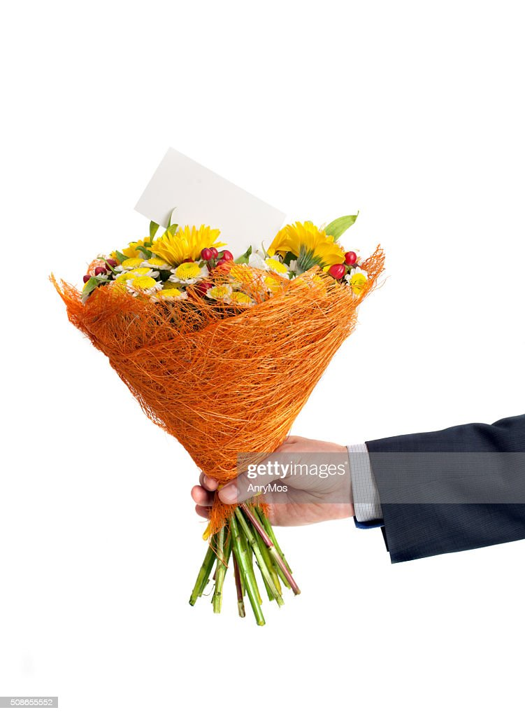 mans hand with a bouquet and a blank greeting card : Stock Photo