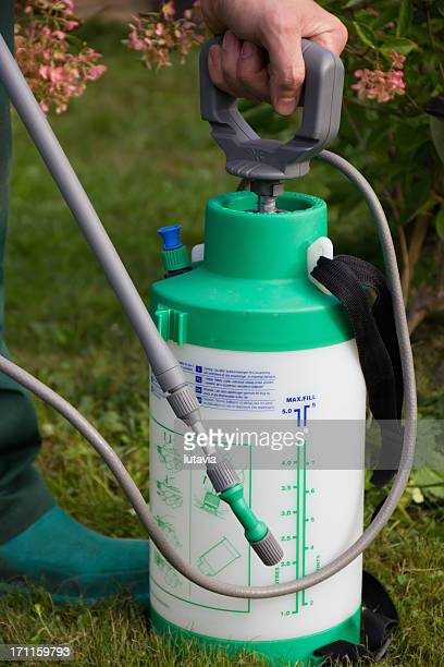 man's hand with a sprayer to fertilize - lutavia stock pictures, royalty-free photos & images